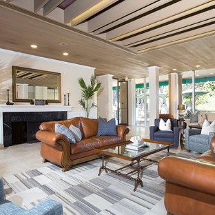 サンディエゴの大きいビーチスタイルのおしゃれなLDK (フォーマル、ベージュの壁、トラバーチンの床、標準型暖炉、タイルの暖炉まわり、ベージュの床) の写真