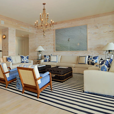 Example of a large island style formal and open concept light wood floor and beige floor living room design in Miami with multicolored walls, no fireplace and no tv