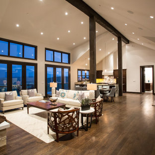 Example of a large trendy formal and open concept dark wood floor living room design in Denver with white walls, a standard fireplace and a stone fireplace