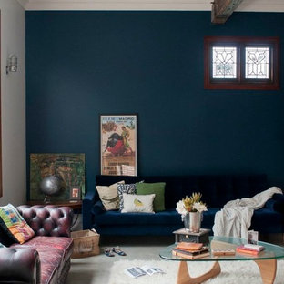 Inspiration for an eclectic concrete floor living room remodel in Perth with blue walls