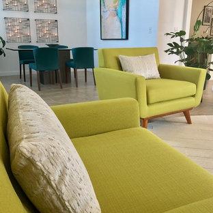Esempio di un soggiorno minimalista di medie dimensioni e aperto con sala formale, pareti bianche, pavimento con piastrelle in ceramica, nessun camino, nessuna TV e pavimento beige