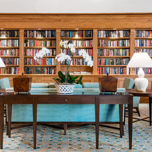 Example of a large trendy open concept carpeted and multicolored floor living room library design in Tampa with brown walls, no fireplace and no tv