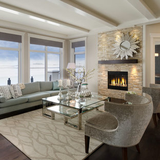 Example Of A Trendy Living Room Design In Calgary With A Stone Fireplace