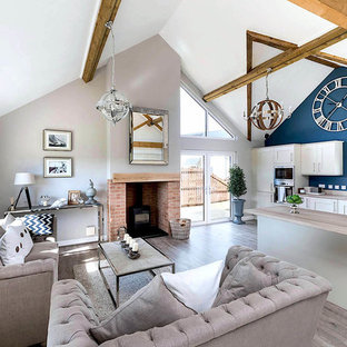 Inspiration for a medium sized nautical open plan living room in Other with a wood burning stove, a brick fireplace surround and grey floors.