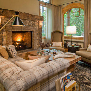 Living room - mid-sized rustic open concept medium tone wood floor living room idea in Denver with a stone fireplace