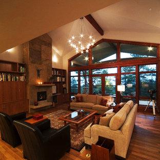 デンバーのトラディショナルスタイルのおしゃれなLDK (フォーマル、ベージュの壁、濃色無垢フローリング、吊り下げ式暖炉、石材の暖炉まわり、テレビなし) の写真