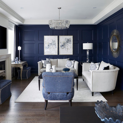 Mid-sized transitional enclosed dark wood floor and brown floor living room photo in Toronto with blue walls, a standard fireplace and a wall-mounted tv
