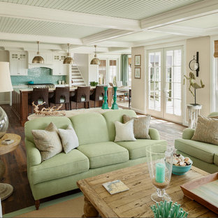 Inspiration for a huge coastal open concept medium tone wood floor living room remodel in Portland Maine with beige walls and a wall-mounted tv
