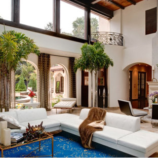 Example of an island style living room design in Atlanta