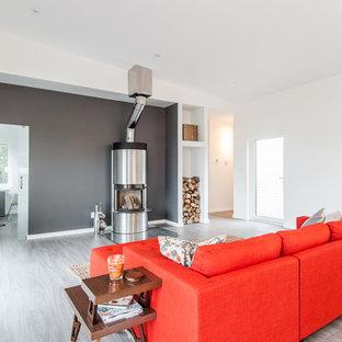Immagine di un grande soggiorno minimal con pareti grigie