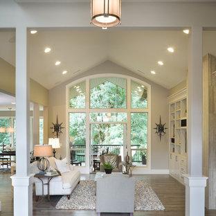 Foto di un grande soggiorno chic aperto con pareti grigie, pavimento in legno massello medio, nessun camino, TV autoportante e pavimento blu