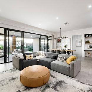 Foto di un soggiorno design aperto e di medie dimensioni con pareti bianche, pavimento grigio e pavimento con piastrelle in ceramica