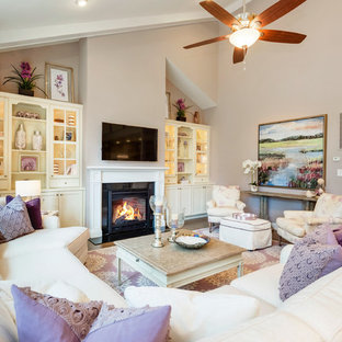 Medium sized romantic formal open plan living room in Other with purple walls, medium hardwood flooring, a standard fireplace, a stone fireplace surround, a wall mounted tv and brown floors.