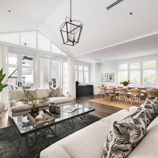 Design ideas for a transitional living room in Perth with white walls, dark hardwood floors and no tv.