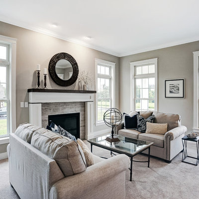 Living room - large farmhouse enclosed carpeted living room idea in Other with beige walls, a standard fireplace, a stone fireplace and no tv