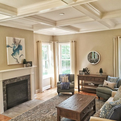 Inspiration for a mid-sized transitional formal and open concept medium tone wood floor living room remodel in Providence with gray walls, a standard fireplace and a tile fireplace