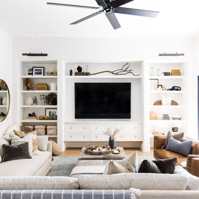 Example of a farmhouse living room design in Phoenix
