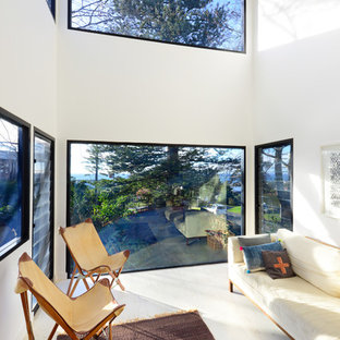 Inspiration for a contemporary living room in Wollongong with white walls, light hardwood floors, no fireplace and no tv.