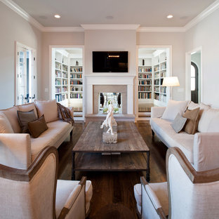 Inspiration for a classic living room in Nashville with a two-sided fireplace, a reading nook and dark hardwood flooring.