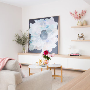 Contemporary formal living room in Melbourne with white walls, light hardwood floors, no tv and beige floor.