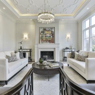 トロントのトランジショナルスタイルのおしゃれな独立型リビング (フォーマル、白い壁、無垢フローリング、標準型暖炉、テレビなし、茶色い床、折り上げ天井、パネル壁) の写真