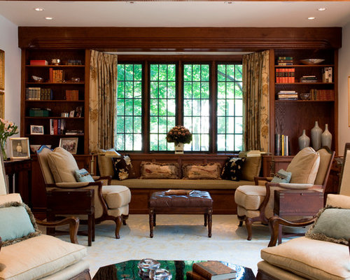 Example Of A Classic Living Room Design In Boston With Library