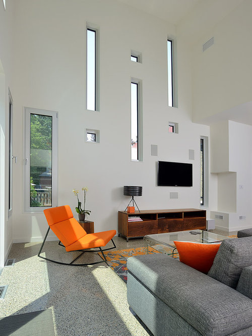 Example Of A Trendy Living Room Design In Toronto With White Walls And Wall