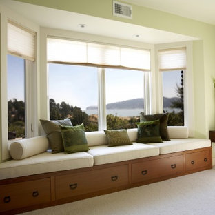 Inspiration for a mid-sized contemporary open concept carpeted living room remodel in San Francisco with green walls and no fireplace