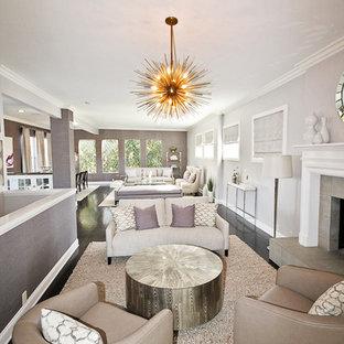 ロサンゼルスの広いトランジショナルスタイルのおしゃれなLDK (標準型暖炉、紫の壁、濃色無垢フローリング、石材の暖炉まわり、テレビなし) の写真