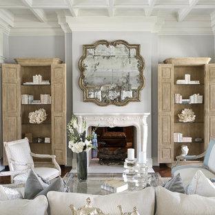 Ispirazione per un ampio soggiorno tradizionale chiuso con camino bifacciale, cornice del camino in pietra, sala formale, pareti grigie e parquet scuro