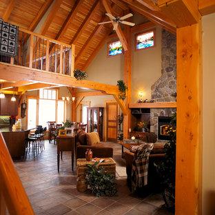 Idee per un soggiorno rustico stile loft con pavimento con piastrelle in ceramica e cornice del camino in pietra