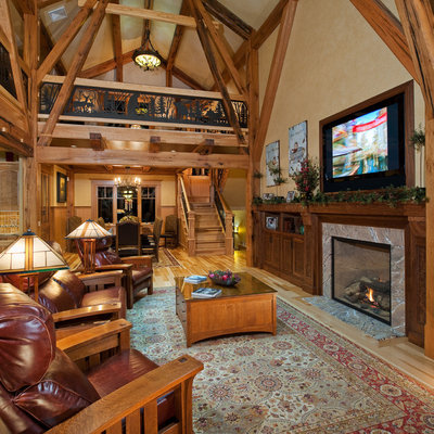 Living room - rustic living room idea in New York with beige walls and a standard fireplace