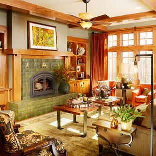 Inspiration pour un grand salon craftsman ouvert avec un sol en bois clair, une cheminée standard, un manteau de cheminée en carrelage, aucun téléviseur et un mur vert.