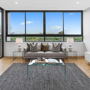 Inspiration for a small contemporary living room in Sydney with grey walls, light hardwood floors and beige floor.