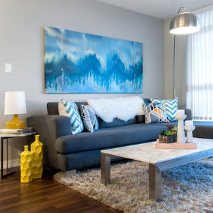 Example Of A Trendy Open Concept Dark Wood Floor Living Room Design In Vancouver With Gray