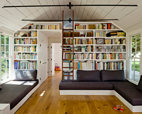 Farmhouse Living Room Idea In Portland With A Library White Walls And Medium Tone Wood