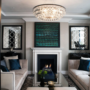 Design ideas for a large traditional formal enclosed living room in London with grey walls, dark hardwood flooring, a standard fireplace, no tv and a plastered fireplace surround.