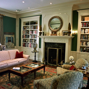 Large traditional formal enclosed living room in Los Angeles with green walls, medium hardwood floors, a standard fireplace, a stone fireplace surround and red floor.