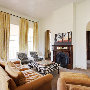 Photo of a transitional formal enclosed living room in Perth with white walls, carpet, a standard fireplace, a wood fireplace surround and no tv.