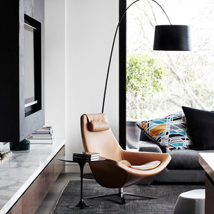 Living room - mid-sized contemporary formal and open concept porcelain floor living room idea in Melbourne with white walls and a media wall