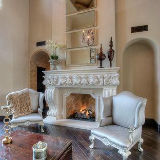 フェニックスの巨大な地中海スタイルのおしゃれなLDK (フォーマル、ベージュの壁、トラバーチンの床、両方向型暖炉、石材の暖炉まわり、テレビなし、マルチカラーの床) の写真
