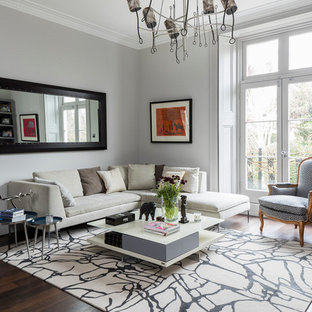 This is an example of a contemporary formal enclosed living room in London with grey walls, dark hardwood flooring and brown floors.