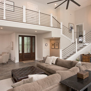 Inspiration for a large traditional open plan living room in Charleston with beige walls, vinyl flooring, no fireplace, a wall mounted tv and grey floors.