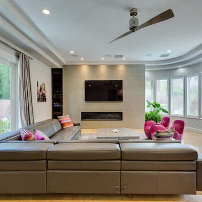 Inspiration for a contemporary beige floor living room remodel in Las Vegas with white walls, a ribbon fireplace and a wall-mounted tv