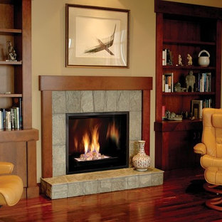 Elegant dark wood floor living room photo in Denver with beige walls, a standard fireplace and a stone fireplace