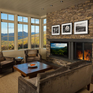 Inspiration for a mid-sized modern formal and open concept medium tone wood floor living room remodel in Other with beige walls, a stone fireplace, a media wall and a standard fireplace