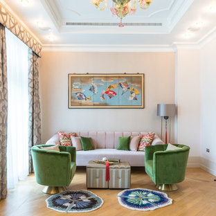 Mid-sized eclectic formal and enclosed medium tone wood floor and brown floor living room photo in London with pink walls