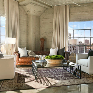 Example of an urban concrete floor and gray floor living room design in Los Angeles with gray walls