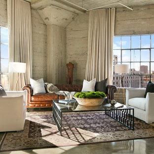 Imagen de salón urbano con paredes grises, suelo de cemento y suelo gris