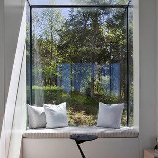 Living room - contemporary medium tone wood floor and orange floor living room idea in New York with white walls